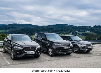 SALZBURG, AUSTRIA - OCTOBER 1, 2017: Jaguar F-Pace, Land Rover Discovery 5 and Range Rover Discovery made a long way to Austria. Photo taken on highway in the Alps near Salzburg.