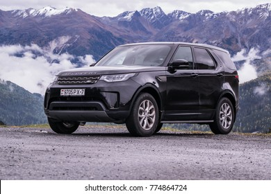 SALZBURG, AUSTRIA - OCTOBER 21, 2017: Land Rover Discovery 5 in the journey across Europe. Photo taken in the Alps in Austria, Switzerland and northern Italy.