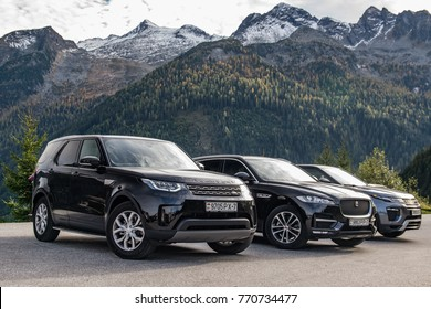 SALZBURG, AUSTRIA - OCTOBER 22, 2017: Jaguar F-Pace, Range Rover Evoque and Land Rover Discovery 5 made a long way to a mountain pass Umbrail in Switzerland.