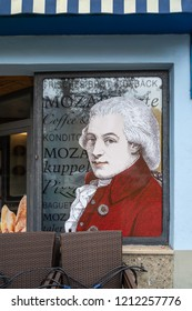 "SALZBURG, AUSTRIA - OCTOBER 30, 2016: A souvenir shop with ""Mozart portrait"" on window in Salzburg city center. Wolfgang Amadeus Mozart (1756-1791) was a famous classical music composer from Austria."