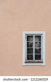 "SALZBURG, AUSTRIA - OCTOBER 30, 2016: The frame of the window with ""Mozart portrait"" at Salzburg city center. Wolfgang Amadeus Mozart (1756-1791) was a famous classical music composer from Austria."