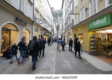 SALZBURG, AUSTRIA - OCTOBER 30: Unidentified People Walking at Famous Historical Shopping Street Getreidegasse in Salzburg, Austria on October 30, 2016