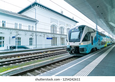 Salzburg, Austria, on August 30, 2018. The regional train has stopped at the platform of the railway station. Passengers go on the platform