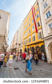Salzburg, Austria - September 11, 2018: Tourists gathered in front of Wofgang Amadeus Mozart's  Birthplace house at Getreidegasse 9 on busy popular shopping street in the old town.