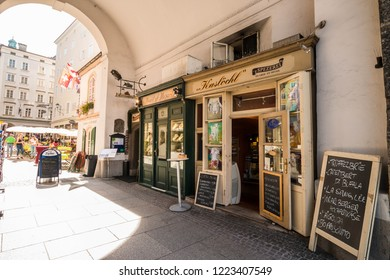 Salzburg, Austria - September 11, 2018: Small shops in the passage near Getreidegasse in the heart of the old town of Salzburg. Dairy products and jewelry shops.
