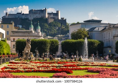 SALZBURG, AUSTRIA - SEPTEMBER 13, 2016 : Colorful beautiful garden view of Mirabell Palace with decorative pools and sculptures. Mirabell Palace is one of the most popular tourist attractions.