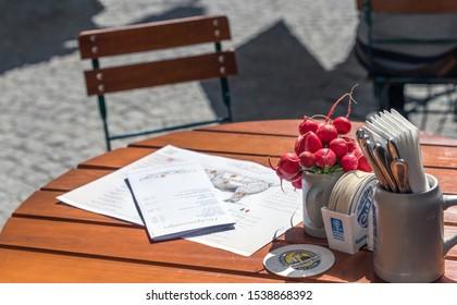Salzburg, Austria - September 2018:  open restaurant table at the city streets