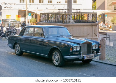 Salzburg, Austria - September 2018: vintage 1968 Rolls Royce Silver Shadow sits parked on town street. Front view of Exclusive Luxury green Rolls Royce Silver shadow II car limousine parked in city.