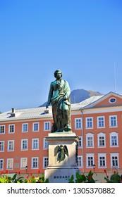 SALZBURG, AUSTRIA - SEPTEMBER 30, 2018: Wolfgang Amadeus Mozart monument statue on Mozart Square Mozartplatz located at Salzburg, Austria. Beautiful summer day. Mozart world famous austrian composer