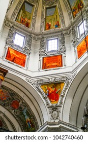 SAlZBURG, AUSTRIA - SEPTEMBER  6 ; Beautifully painted religious frescoes or ceiling paintings high up in dome of Salzburg Cathedral September 6 2017 Salzburg Austria