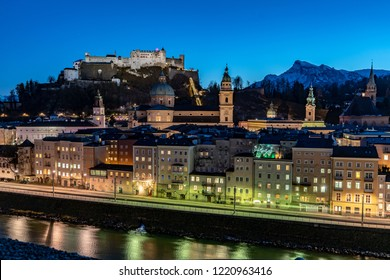 Salzburg by night panoramic view with the Salzburg Fortress and the Cathedral visible