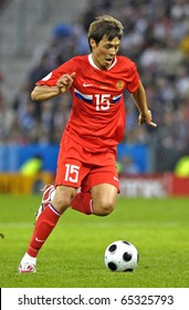 SALZBURG - JUNE 14:  Russian midfielder Diniyar Bilyaletdinov n.15 during the match Greece-Russia during the Euro2008 Group D. June 14, 2008, in Salzburg, Austria