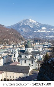 Salzburg Skyline.  The view across Salzburg's Old Town in Austria.  In the foreground is Collegiate Church and in the background is Gaisberg a mountain to the East of the city.