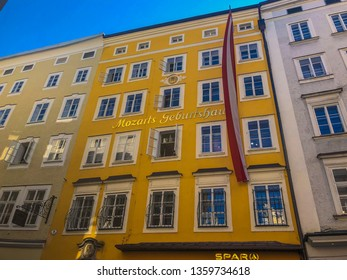 Salzburg/Austria - October 10, 2018:The yellow building is the birthplace of Wolfgang Amadeus Mozart at No. 9 Getreidegasse in Salzburg. The Mozart family resided on the third floor from 1747 to 1773.