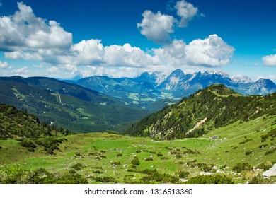 Salzburger Land, Austria - MAY 24 2011: Austrian alpine landscape, alp with beautiful cabins, Salzburger Land, Austria