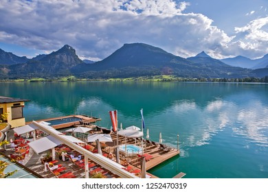 SALZKAMMERGUT, AUSTRIA - SEPTEMBER 19, 2018: Photo of picturesque lake Wolfgangsee on the background of mountains.
