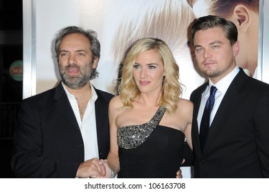 Sam Mendes with Kate Winslet and Leonardo DiCaprio   at the World Premiere of 'Revolutionary Road'. Mann Village Theater, Westwood, CA. 12-15-08