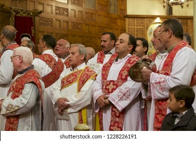 SAMALLOUT, EGYPT - JANUARY 6, 2013: choir of deacons singing at the Coptic Christmas mass service, cathedral of Samallout, Middle Egypt.