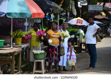 Saman Dewala(The Buddhist Temple) , Rathnapura town/Sri Lanka - May 7 2016 : People are buying some flowers from selling women for offering to the Saman God.