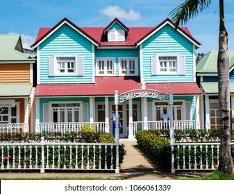 Samana, Dominican Republic. 03.20.2018: Beautiful turquoise pastel Traditional Caribbean house in Samana, Dominican Republic. blue sky with clouds