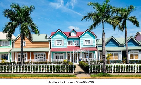 Samana, Dominican Republic. 03.20.2018: Beautiful pastel Traditional Caribbean house in Samana, Dominican Republic. blue sky with clouds and palm trees.