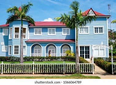 Samana, Dominican Republic. 03.20.2018: Beautiful blue pastel Traditional Caribbean house in Samana, Dominican Republic. blue sky with clouds and palm trees.