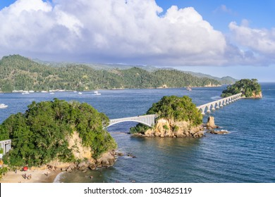 SAMANA - DOMINICAN REPUBLIC. Samana bridge. Beautiful separate standing rocky islands connects with the promenade bridge. Green hills with palmtrees on the background. Sunny weater and cloudy sky.
