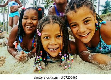 Samana, Dominican Republic - June 4, 2010: Children running on the beach