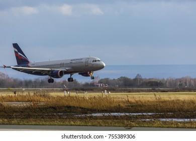 Samara, Russia - 31October 2017: Landing airplane on airplane runway. Kurumoch airport was renovated in 2015.