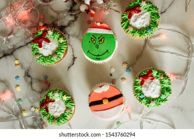 Samara, Russia - 7.10.2019: Christmas cupcakes decorated with cream and made in the form of a Grinch who stole Christmas.