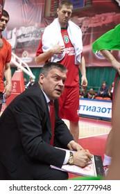 SAMARA, RUSSIA - APRIL 06: Time out. Coach of BC Lokomotiv-Kuban Evgeny Pashutin says the game plan against BC Krasnye Krylia on April 06, 2013 in Samara, Russia.