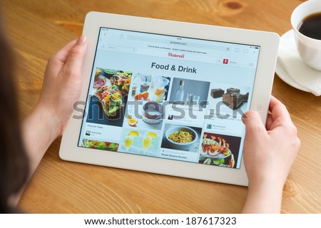 Samara, Russia - April 08, 2014: Close up of pinterest website on a ipad screen. Pinterest announces a new application for mobile devices