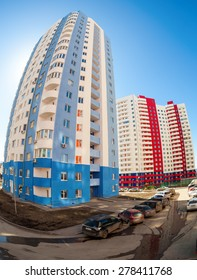 SAMARA, RUSSIA - APRIL 12, 2015: Tall apartment buildings under construction against blue sky background