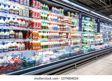 Samara, Russia - April 13, 2019: Various fresh dairy products ready for sale in chain hypermarket. Packaged milk as background