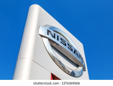 Samara, Russia - April 20, 2019: Nissan official dealership sign against blue sky. Nissan is a Japanese multinational automaker