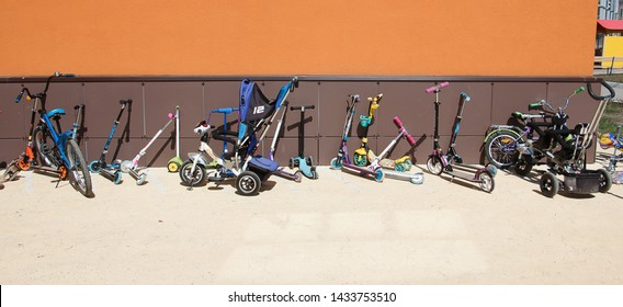 Samara, Russia - April, 2019: Parking of children's bicycles at the entrance of the kindergarten in the southern city. while the kids are resting