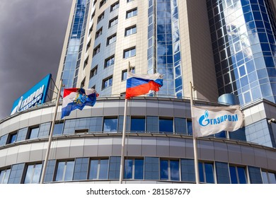 "SAMARA, RUSSIA - APRIL 26, 2015: Flags near the administrative and supervisory office of LLC ""Gazprom Transgaz Samara"""