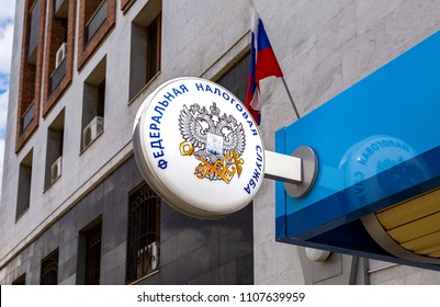 Samara, Russia - April 30, 2018: Signboard with emblem of the Russian Federal Tax Service on the wall of building