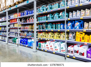 Samara, Russia - April 7, 2019: Different plastic canisters with motor oil ready to sale at the chain hypermarket