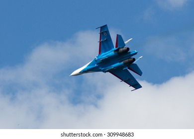 """Samara, Russia - August 22. 2015: Demonstration performances of flight group """"Falcons of Russia"""" on Su-27. Airshow devoted to the celebration of the National Flag of the Russian Federation"""