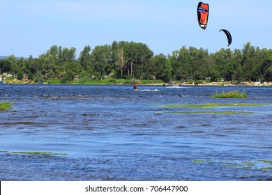 Samara, Russia - August 28, 2016. sports leisure; kite-surfers ride a soaring parachute and catch the wind
