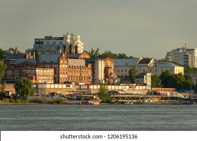Samara, Russia - August 7, 2018: Panorama of Samara and the embankment of the city. View from the Volga at sunset of the day.