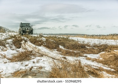 SAMARA, RUSSIA - CIRCA 2016: Land Rover Defender participates in winter offroad trip on the track across the forest. Land Rover Defender is a legendary offroad vehicle with over 68 years history.