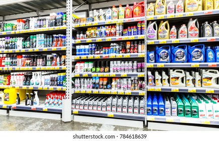 Samara, Russia - December 15, 2017: Different plastic canisters with motor oil and car chemistry ready to sale at the Lenta store