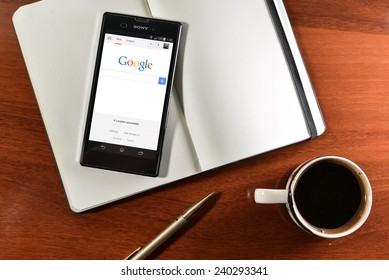Samara, Russia - December 28, 2014:Google app open in the mobile phone SONY Xperia. Sony Corporation main direction rapidly developing market of smartphones. Google free application