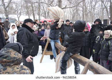 SAMARA, RUSSIA - FEB 26:  People celebrating Russian religious and folk holiday Maslenitsa, bags battle, Zagorodny park, February 26, 2012, Samara, Russia