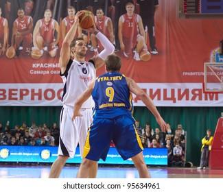 SAMARA, RUSSIA - FEBRUARY 04: Fedor Likholitov of BC Krasnye Krylia, with ball, is on the attack during a BC Khimki game on February 04, 2012 in Samara, Russia.