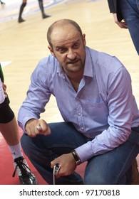 SAMARA, RUSSIA - FEBRUARY 15: Time out. Coach of BC Budivelnik Zvezdan Mitrovic says the game plan against BC Krasnye Krylia on February 15, 2012 in Samara, Russia.