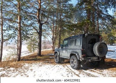 SAMARA, RUSSIA - February 2017: Land Rover Defender participates in offroad trip on the track across the forest. Land Rover Defender is a legendary offroad vehicle with over 68 years history.