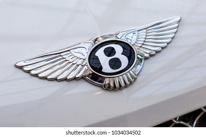 "Samara, Russia - February 25, 2018: Bentley logo ""Flying B"" on the car. Bentley Motors Limited is a British manufacturer of luxury automobiles"